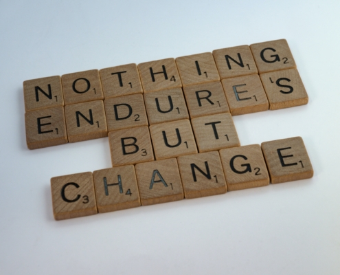 scrabble pieces spelling out nothing endures but change
