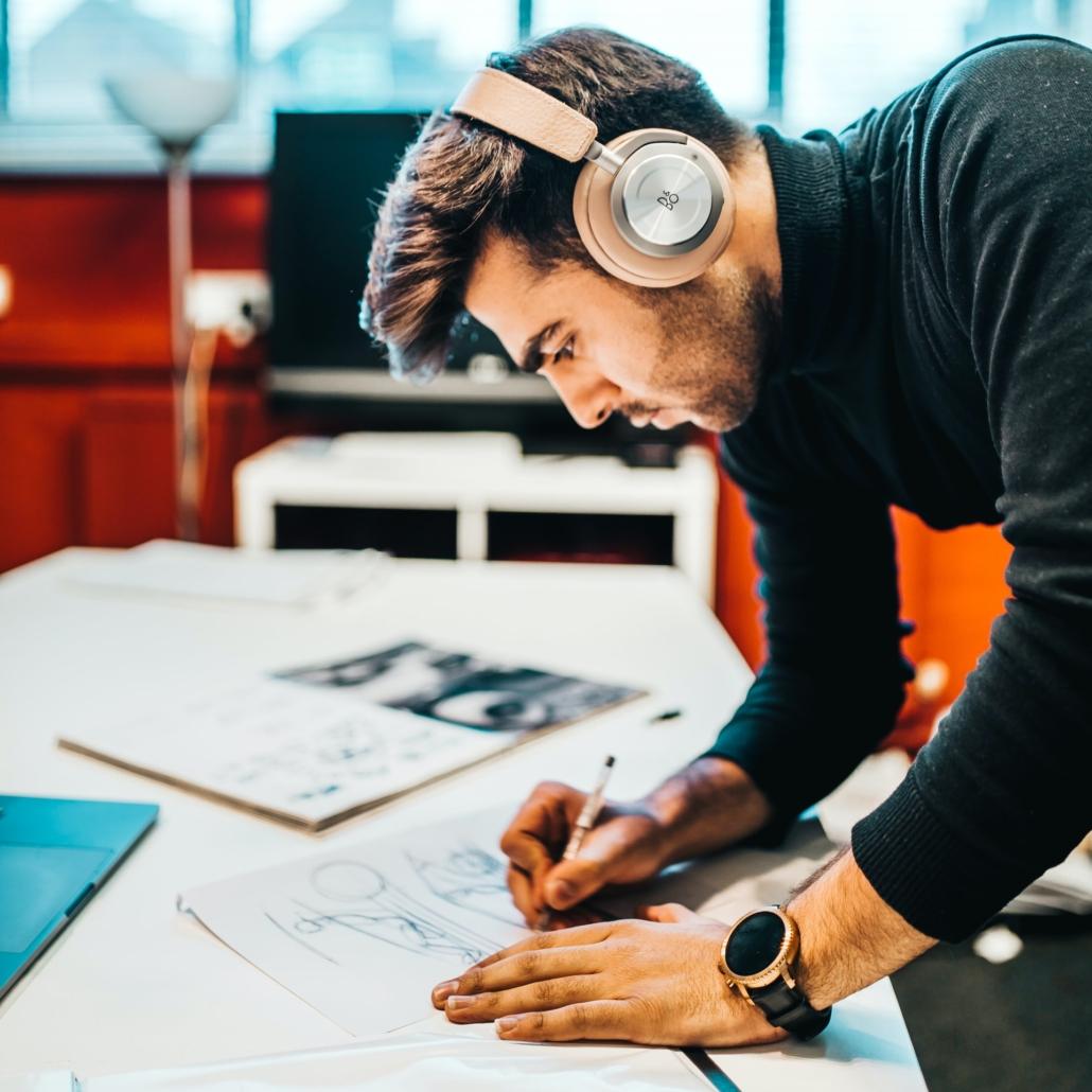 man sketching at desk cfas
